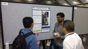 AOSense Physicist Akash Rakholia (center) presenting a poster at DAMOP 2017